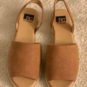 Beige sandal with white bottom